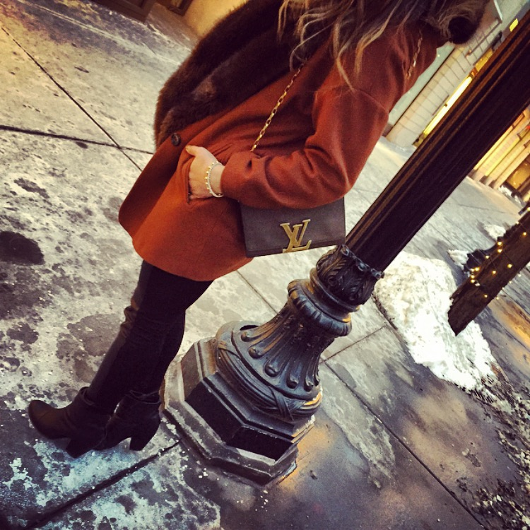 winter chic style with a louis vuitton belt and orange coat