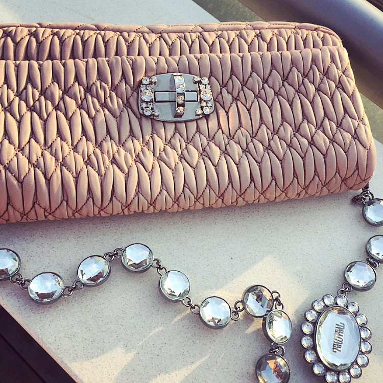 girly pink miu miu clutch and gems