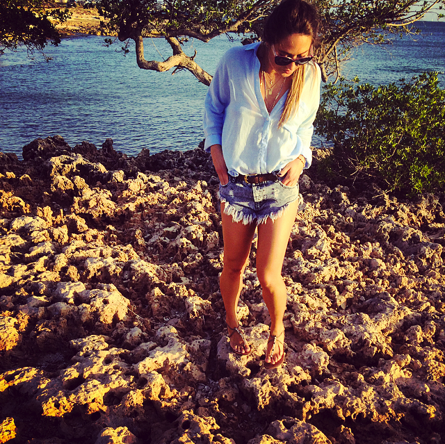 walking on the rocky beach in aruba
