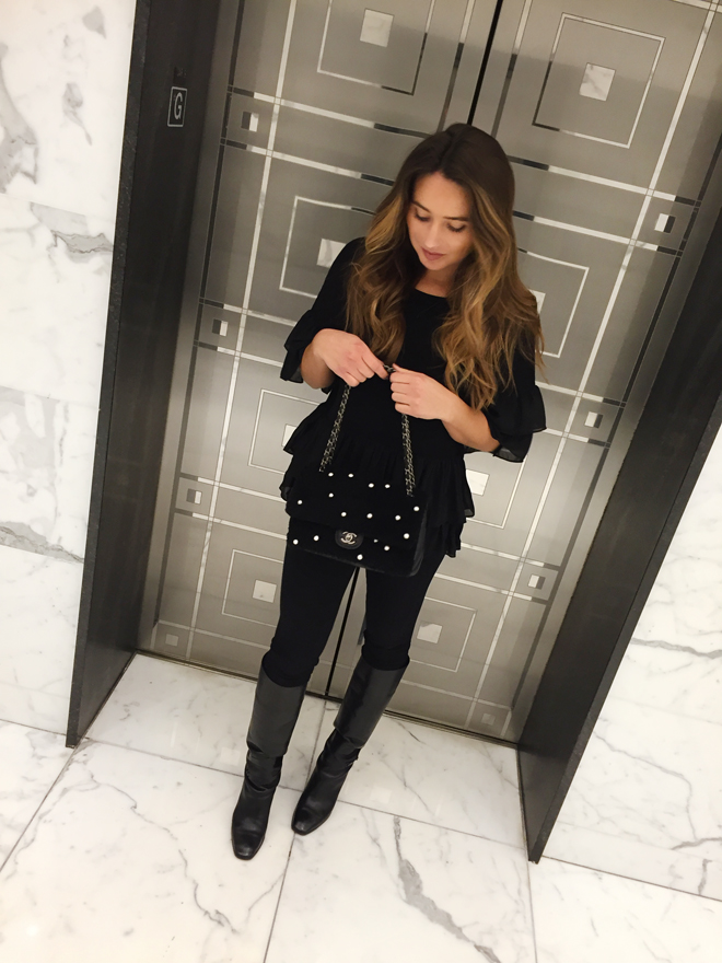 black blouse with leggings, boots and chanel purse
