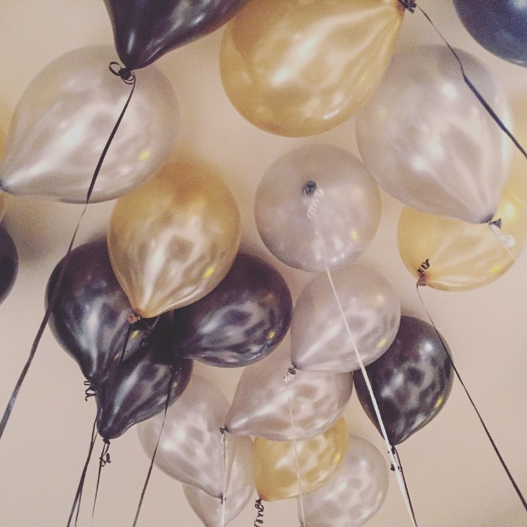 black, silver and gold party balloons
