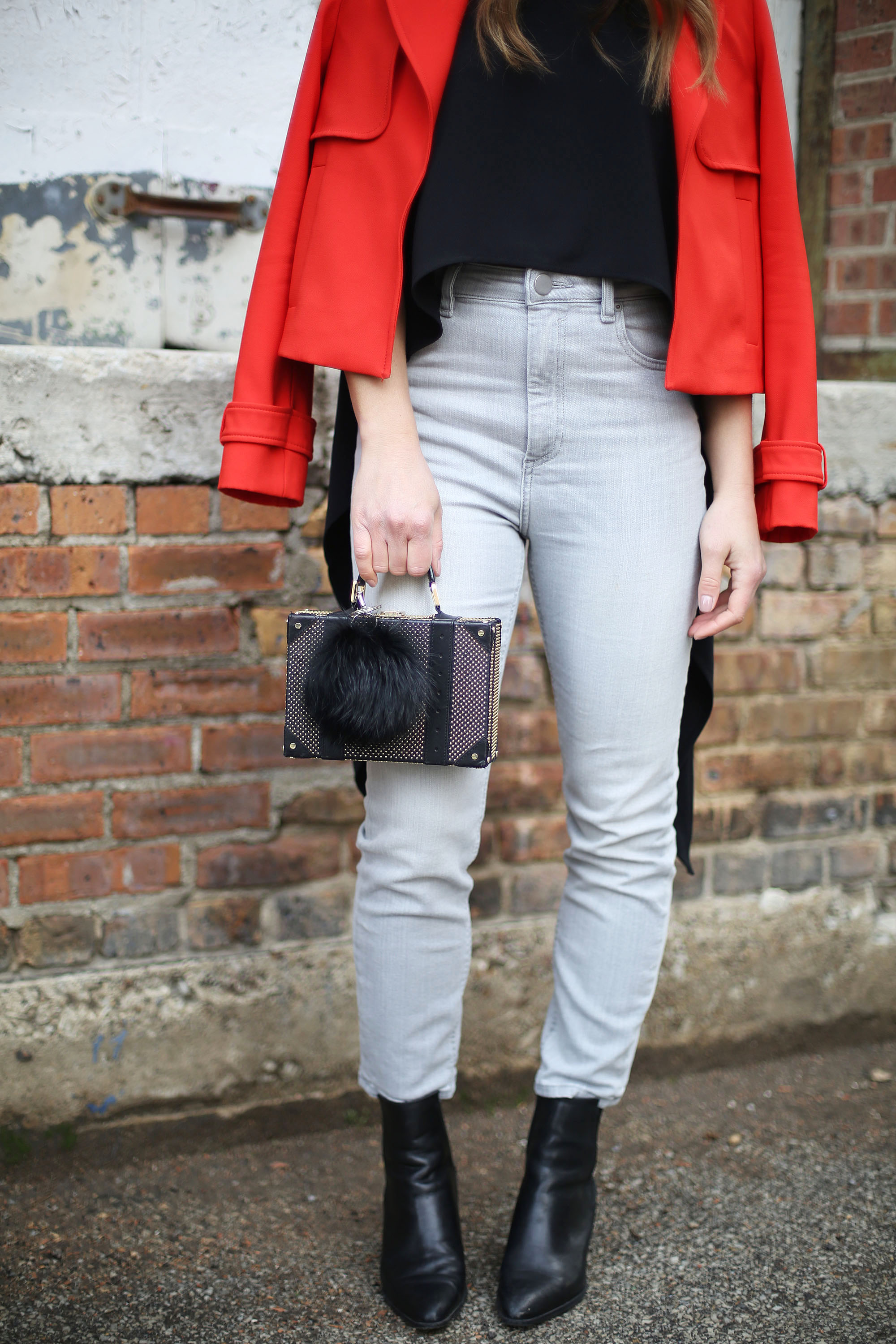 alice-and-olivia-box-clutch-fur-pom-grey-jeans
