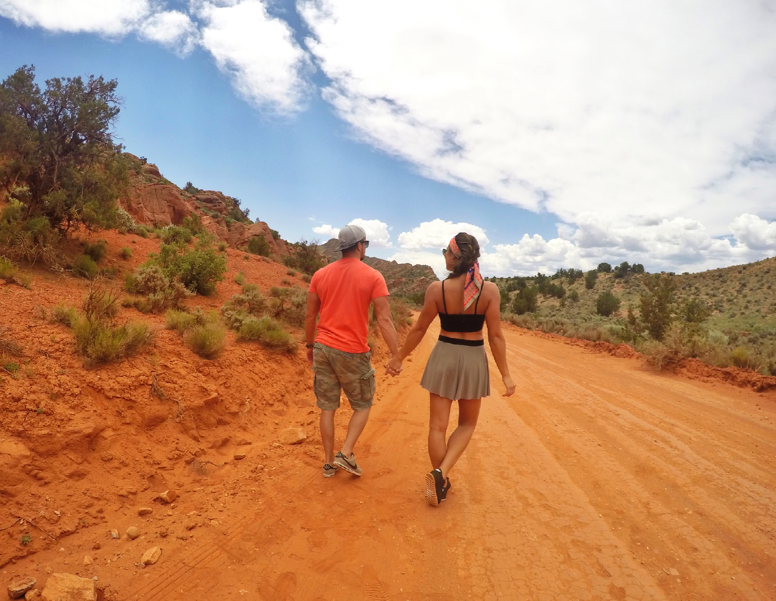 girl-and-boy-holding-hands-in-the-desert