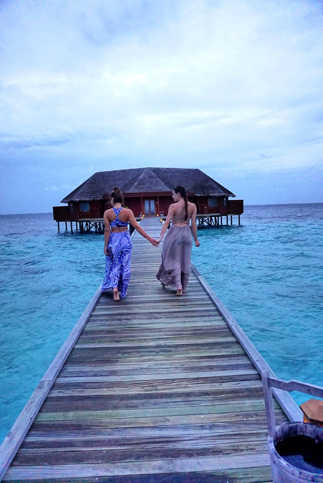 sisters-walking-on-pier