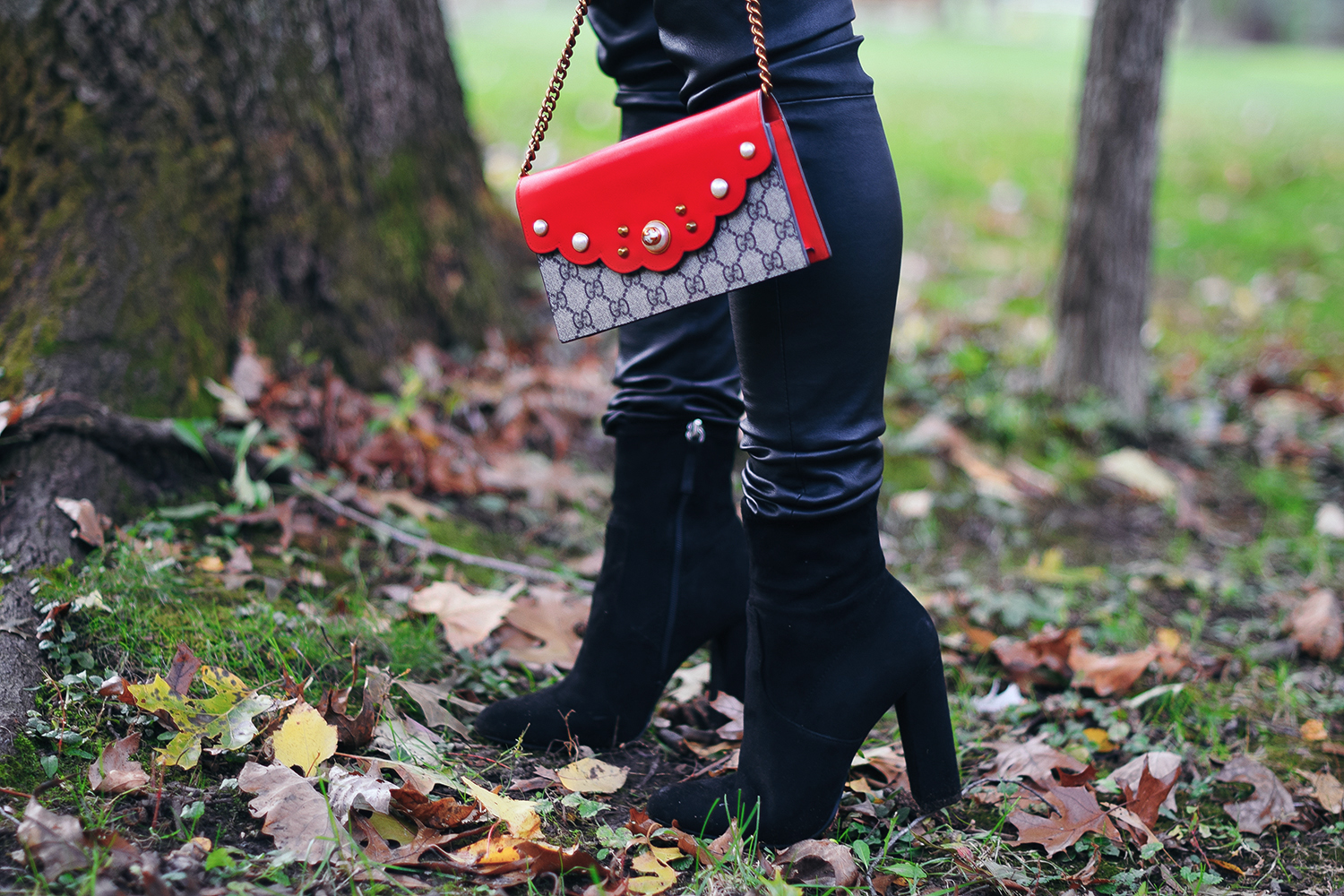 red-gucci-purse-black-booties