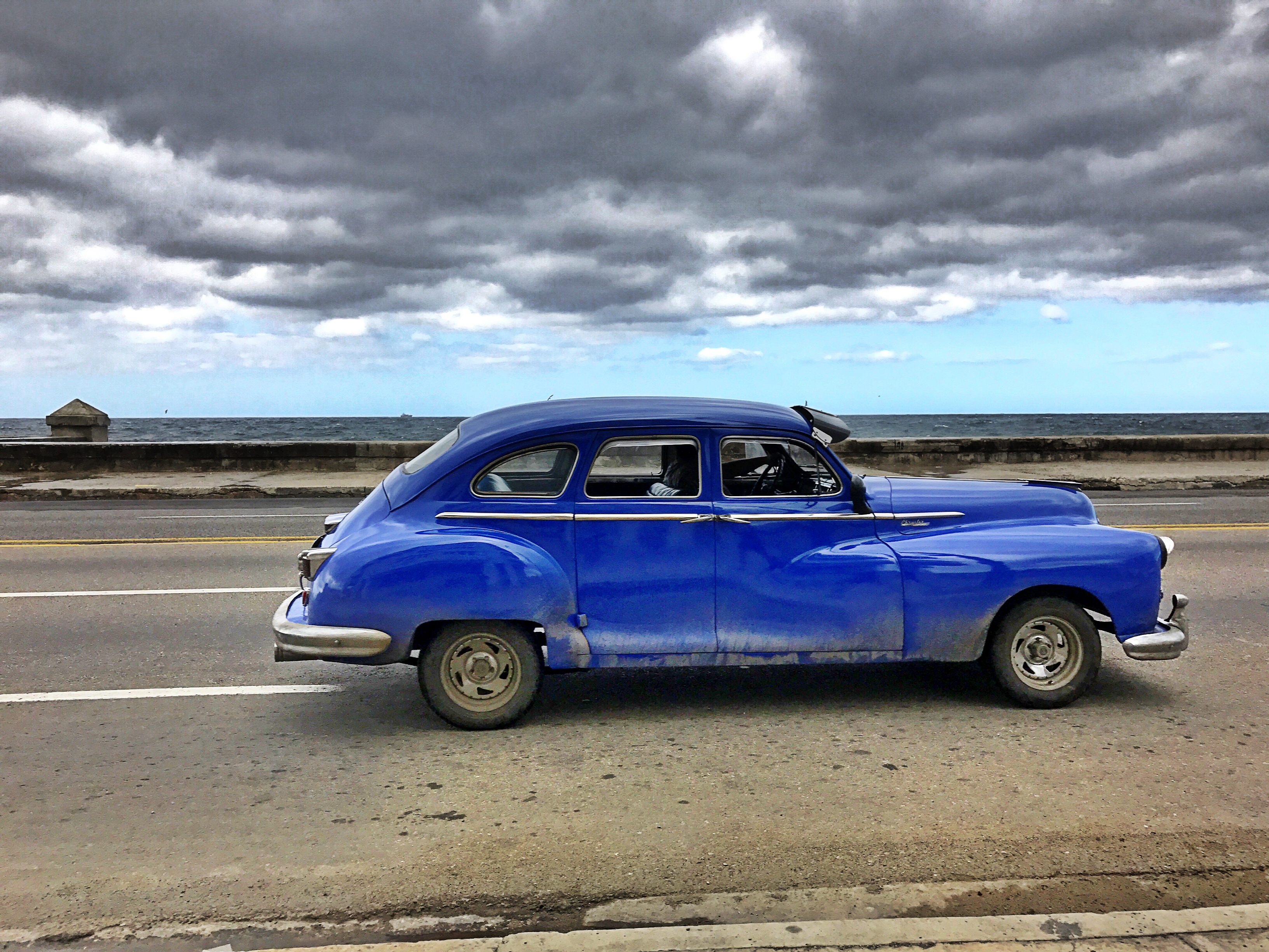 blue-car-on-malecon-old-havana