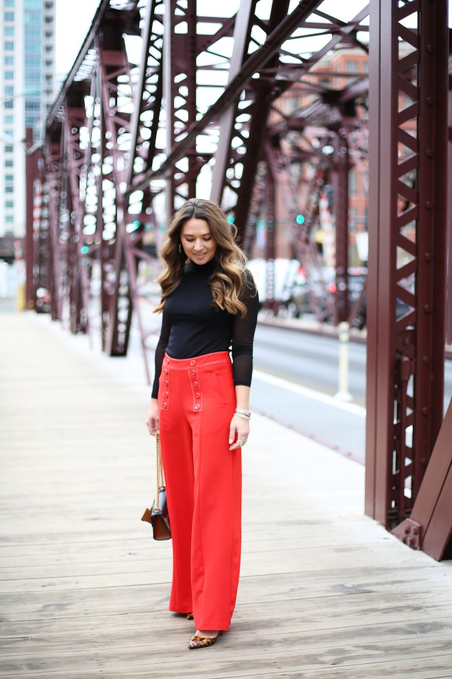 standing-on-the-bridge-cute-outfit-red-pants-black-top